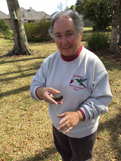 Newfield holds a banded hummingbird in 2014